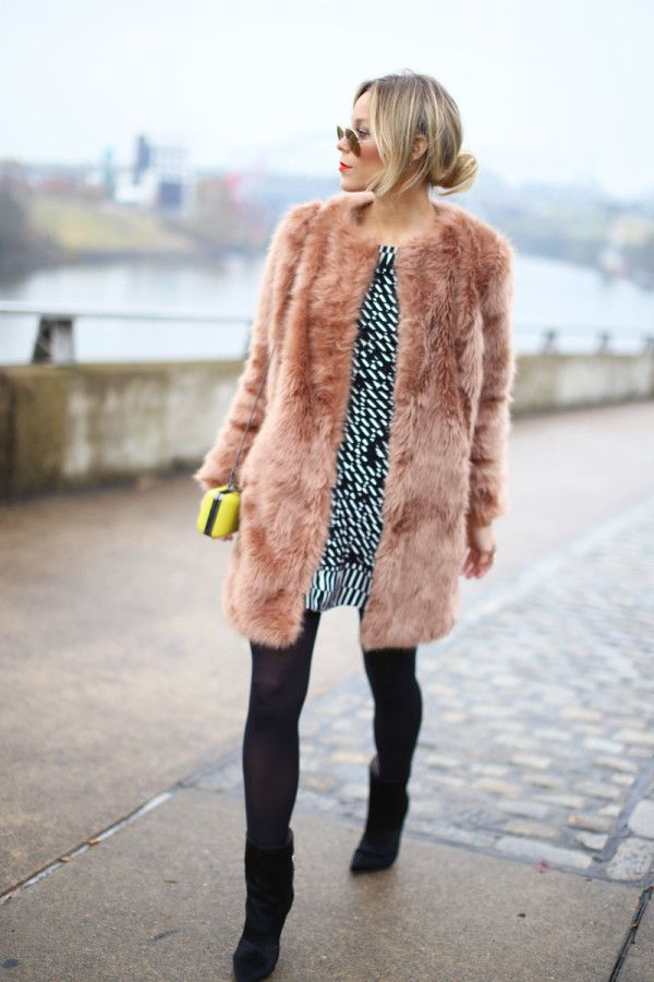 Fuzzy tan coat, blk/white dress with blk tights and blk booties. Add bright colored bag-lime.