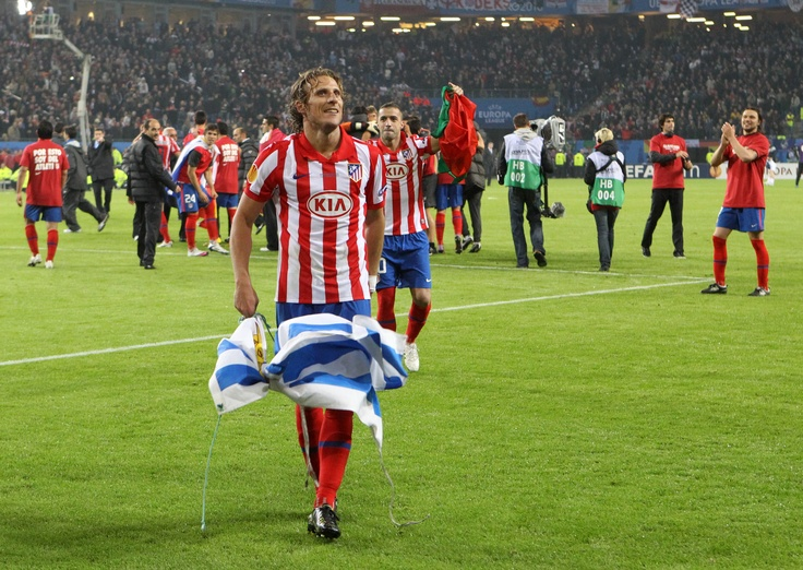 Diego Forlan celebrating after the final whistle.