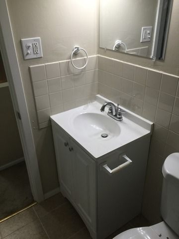 Vanity, Faucet and Mirror Installation.
