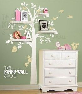 Tree wall decal - white on colored wall with shelves.