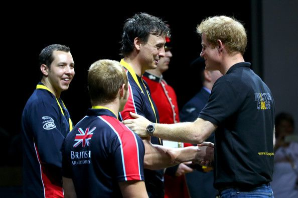 Prince Harry Photos Photos - Prince Harry presents Nick Beighton of Great Britain with his medal during a medal ceremony after the Indoor Rowing at Here East during day three of the Invictus Games, presented by Jaguar Land Rover at Queen Elizabeth Olympic Park on September 13, 2014 in London, England. - Invictus Game: Day 3