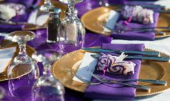 Purple napkins, purple table runners, gold decorative charger plates are in Kono's inventory