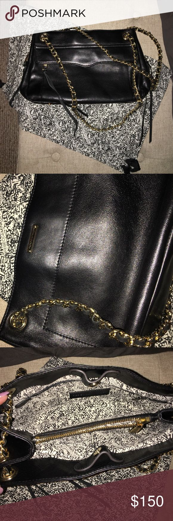 Rebecca Minkoff Swing Double Chain Purse Black Rebecca Minkoff purse (SWING double chain). Used once and like new. No scratches. Comes with original storage bag. See fourth photo for pocket organization on the inside. Has an outside pocket as well. Rebecca Minkoff Bags Shoulder Bags