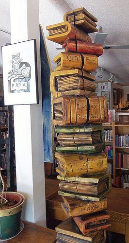 wooden books statue: Aquila Books in Calgary, Alberta, Canada;  photo by Literary Tourist