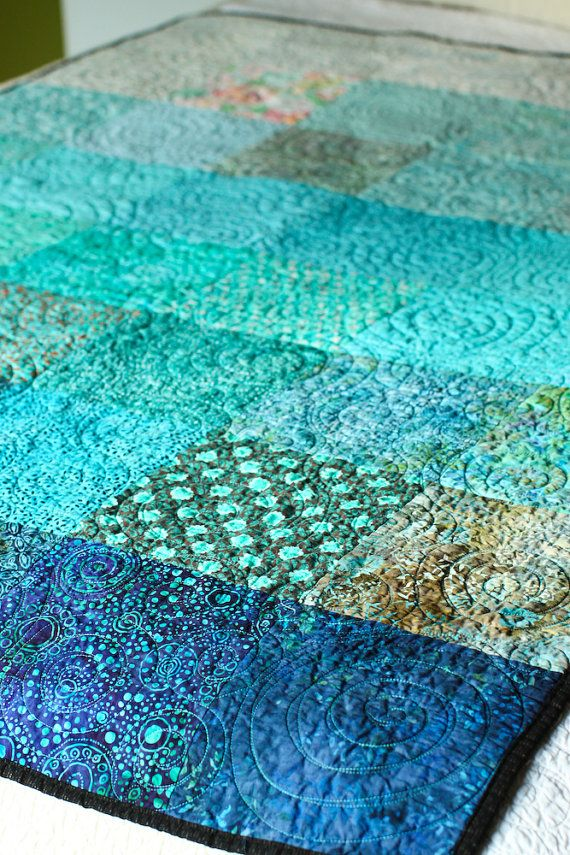This quilter does gorgeous work! LOVE this aqua quilted throw. Perfect for a nap on the couch or folded across the foot of the bed. A bargain for such exquisite work. $255