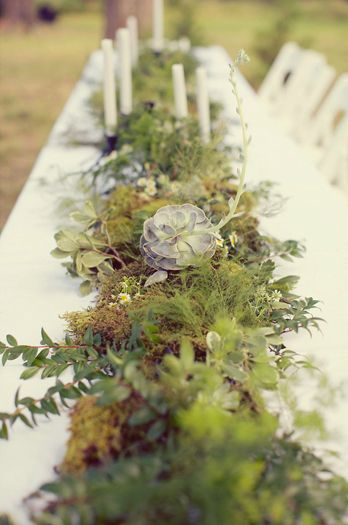 Rustic greenery and wildflower centerpiece.   Photo by Sarah Kate Photographer.