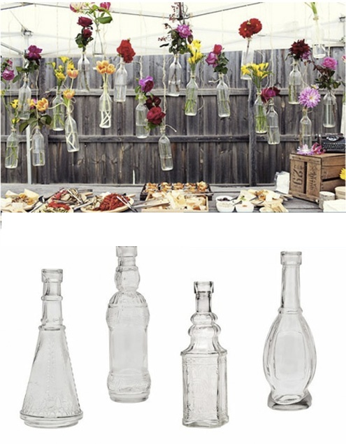 Flowers in bottles suspended how cool!
