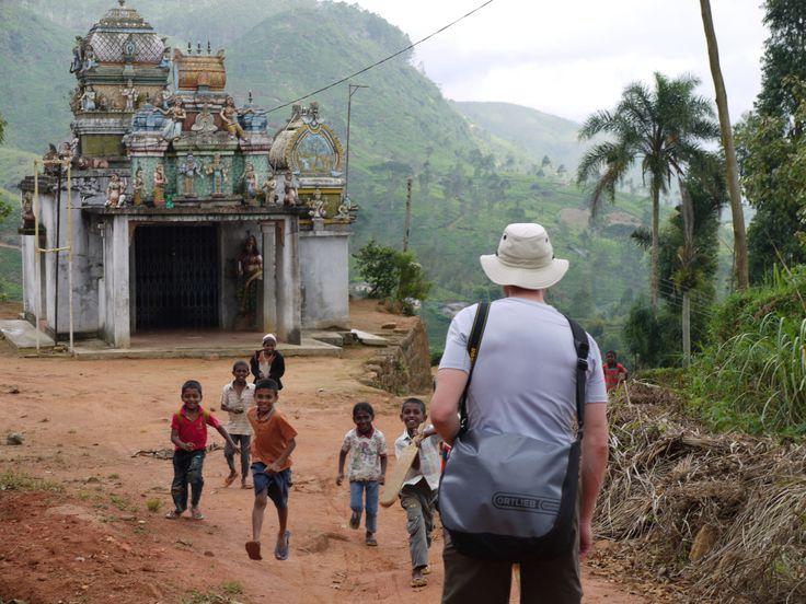 A rock star welcome for Seven Skies' founder Nathan Wedding trekking through villages in Sri Lanka's tea fields.