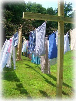 Hung the clothes outside to dry in the sun and wind with clothes pins on the clothes line . Clothes smelled fantastic!