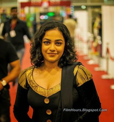 Nithya Menon hot stills spicy photos actress glamour navel pictures large HD images collection