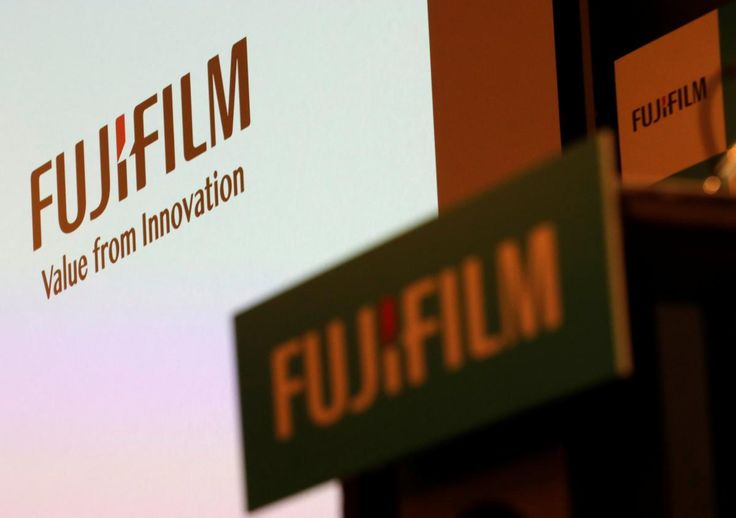 Japan's Fujifilm Holdings is set to take over Xerox Corp in a $6.1 billion deal, combining the U.S. company into their existing joint venture to gain scale and cut costs amid declining demand for office printing.