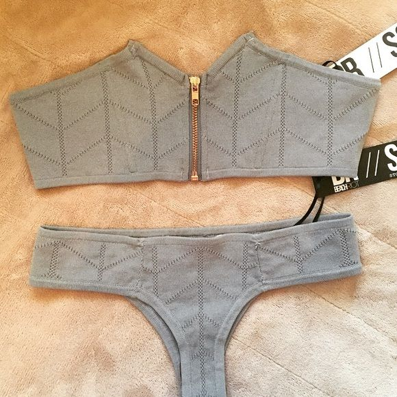 NWT Beach Riot x Stone Cold Fox Bikini I love this but have way too many bikinis. It's brand new with tags and hygienic liner. The price is for top AND bottom, both size S. The top is called St Tropez and the bottoms are slightly cheeky. The color is GRAY and the last pic shows the coverage on the bottoms. The material is 82% nylon 18% spandex Stone Cold Fox Swim Bikinis