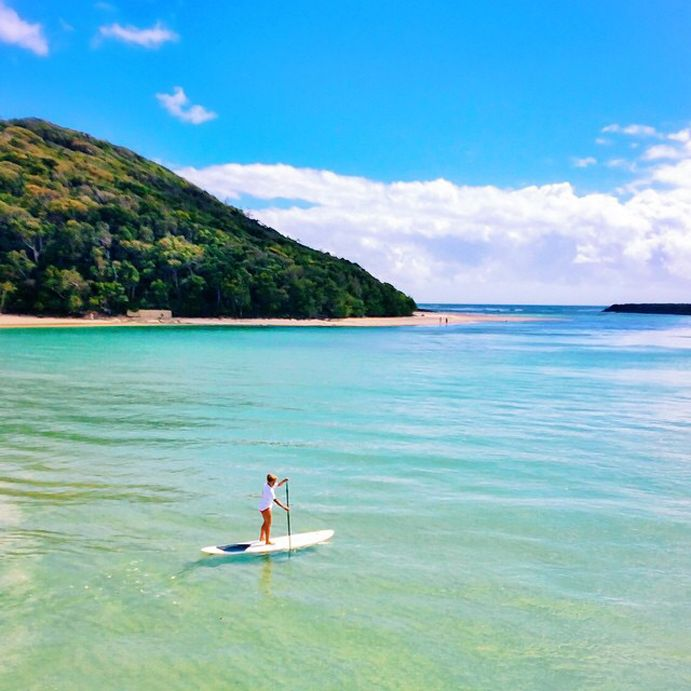 Where to SUP in Queensland Photo by @kpinko. SUP at Tallebudgera Beach, #visitgoldcoast #thisisqueensland