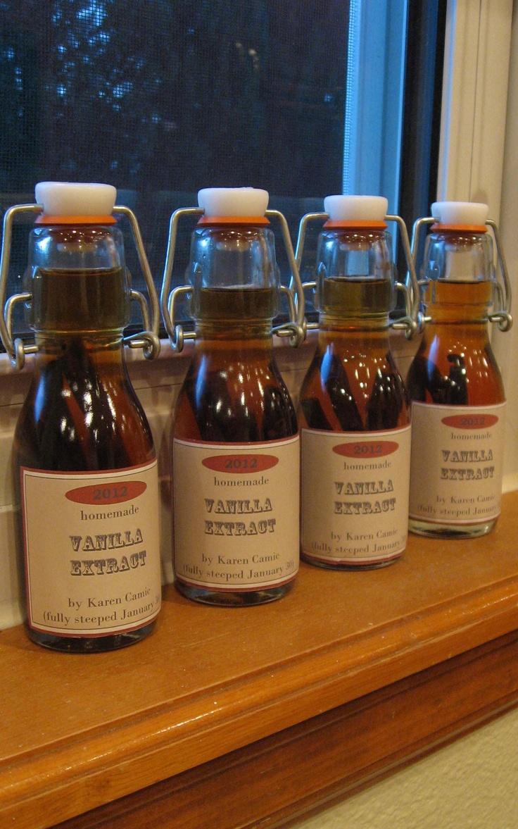 Homemade Vanilla with labels - I made mine by adding two Madagascar vanilla beans to good quality Vodka (Svedka), then poured it into cute glass bottles and added a custom homemade label. Great gift idea -- I used this site for the vanilla recipe -- http://bethanyactually.com/make-your-own-vanilla-extract/