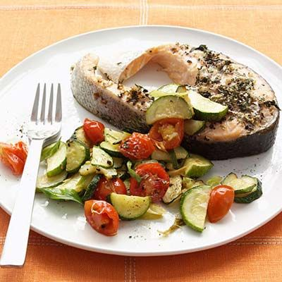 The garden-fresh taste of gently cooked zucchini and cherry tomatoes pairs beautifully with rich, hearty salmon steak.Recipe: Herb-Rubbed Salmon Steak