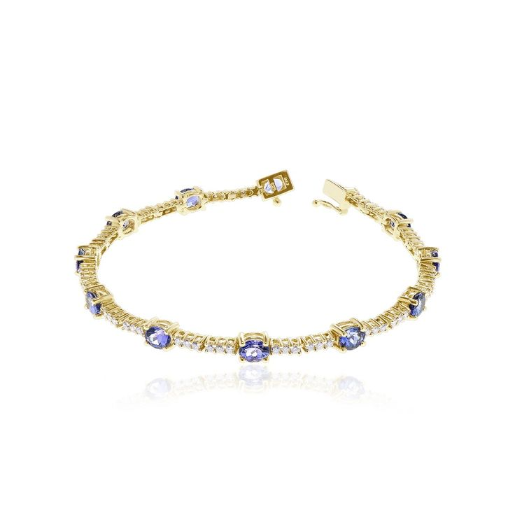 """14kt yellow gold tanzanite and diamond bracelet, measuring approx. 7"""" in length, with interlocking clasp and safety catch."""