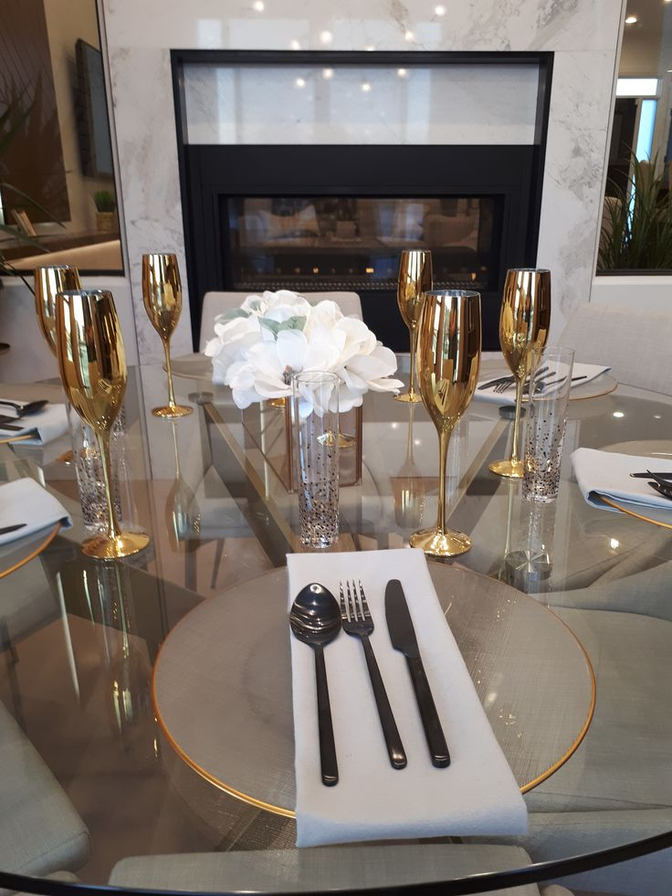These gold place settings are anything but boring. We love that this dining room with a double sided fireplace. The living room is just on the other side.