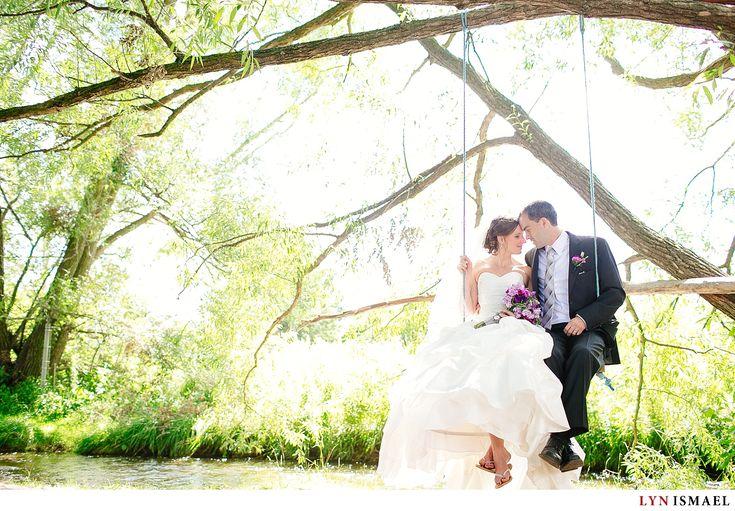 Heidi and Larry | Wedding Documentarian in Waterloo | Bride and groom on a swing.