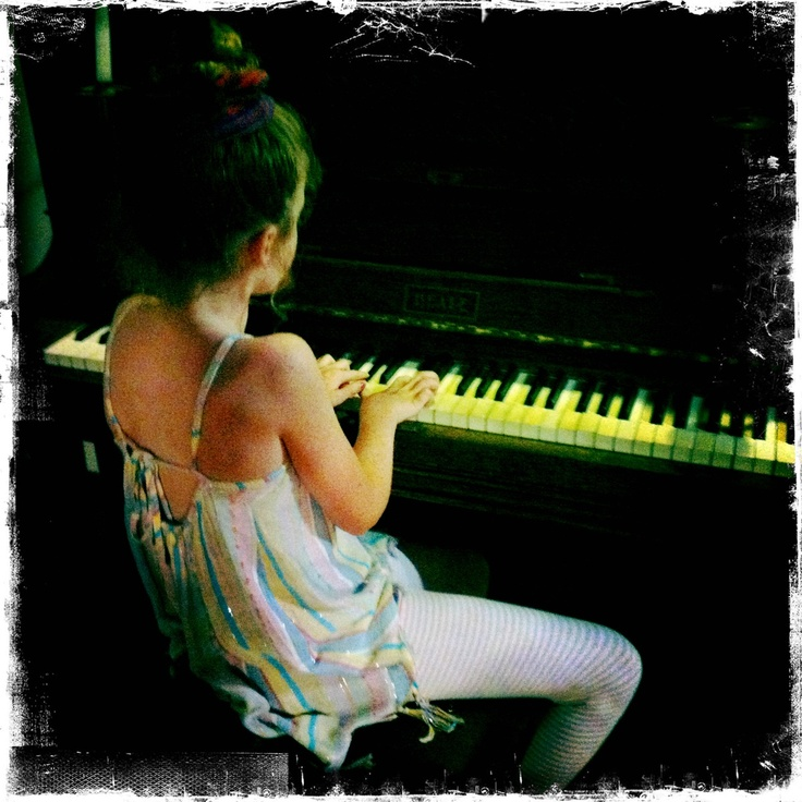 Emma doing her thing on her great great grand ma's piano