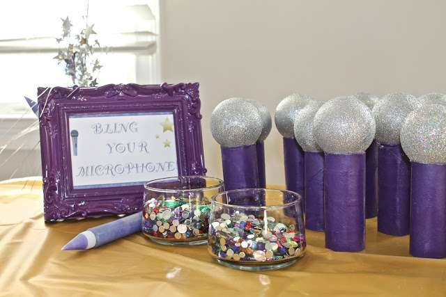 Bling your microphone activity at a purple popstar birthday party!  See more party planning ideas at CatchMyParty.com!