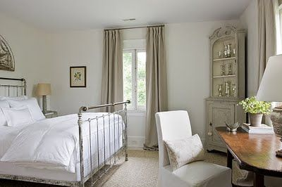 linen and white bedroom . . . I like the mix of wood desk with upholstered chair in front of the window.