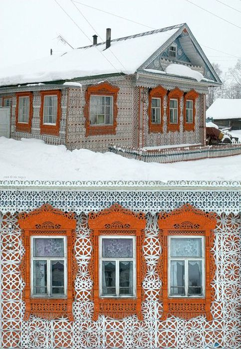 This Russian lady has done a big job decorating her house. All those elements were hand carved from wood and then carefully installed in plac
