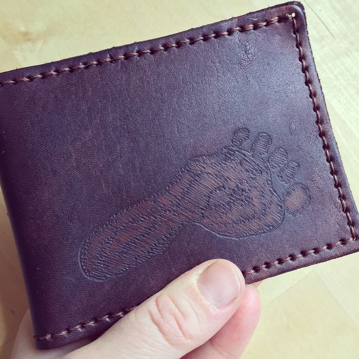 Sometimes you can say more with an image than you can with words.  This custom wallet has the little footprint from a three year old boy on it.  A sweet and sentimental gift for dad, who can always carry his baby with him.