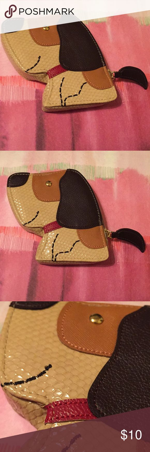 NWOT Dressbarn dog puppy face coin purse 🎶🎵how much is that doggie in the window🎵🎶 Suuuper cute puppy dog coin purse! Looks kind of like a hound or a beagle 🐶💕 snakeskin like and a variety of patterned leather like materials make up this must have! Red collar, gold button eye, oh and the tail is the zipper! 😍 this one is for all the proud dog mommas! Similar to: Kate Spade, Coach, Betsey Johnson. Sand, tan, and chocolate in color. Dress Barn Bags Wallets