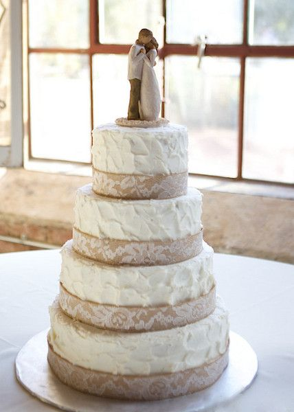Rustic wedding cake with textured white frosting and  burlap and lace ribbons {Holly L. Robbins Photography}