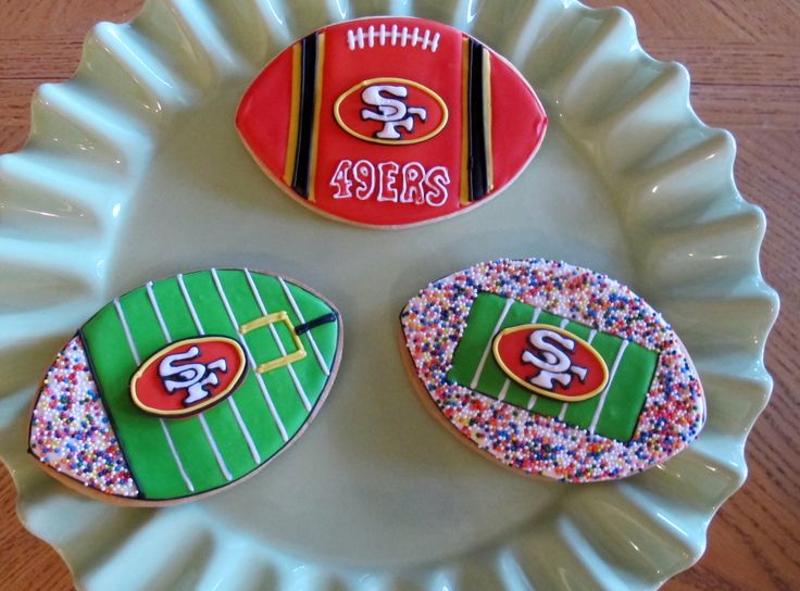 Tricia Zunino - Football team sugar cookies.  I would make your team logo in royal icing and then attach it to the cookie after all the flooding/decorating had been done.