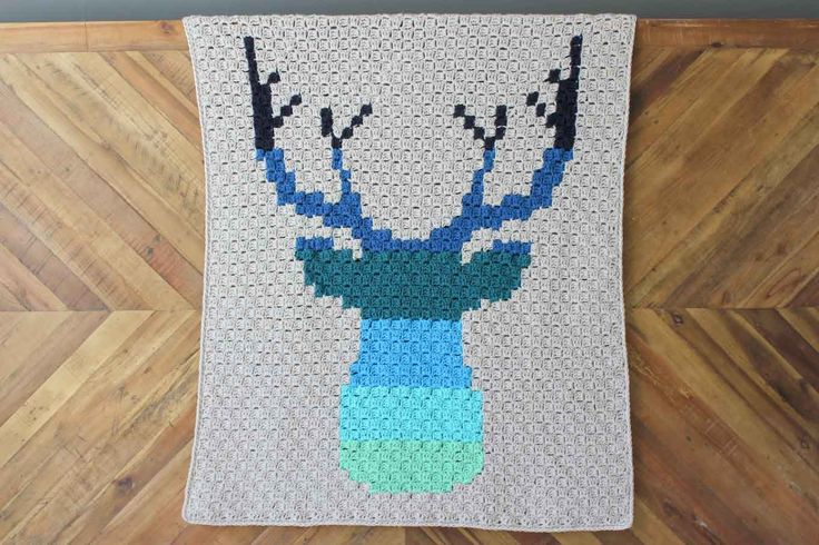 This corner to corner crochet deer afghan is perfect for your favorite baby, hipster or hunter! Free pattern in two sizes--baby blanket and larger throw.