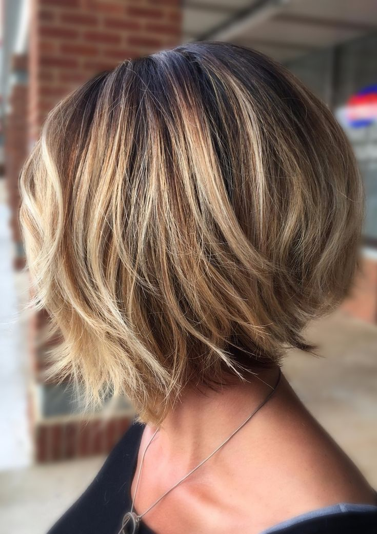 This look is achieved with Balayage highlights for sombre look. She also has an undercut for a modern bob look. – Michaela F.-W.