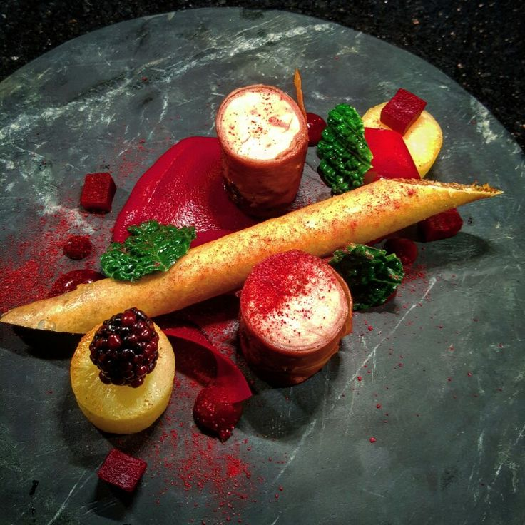 Local pheasant breast in ham, confit leg pastry straw, roast potato, variations of beetroot, blackberry jus