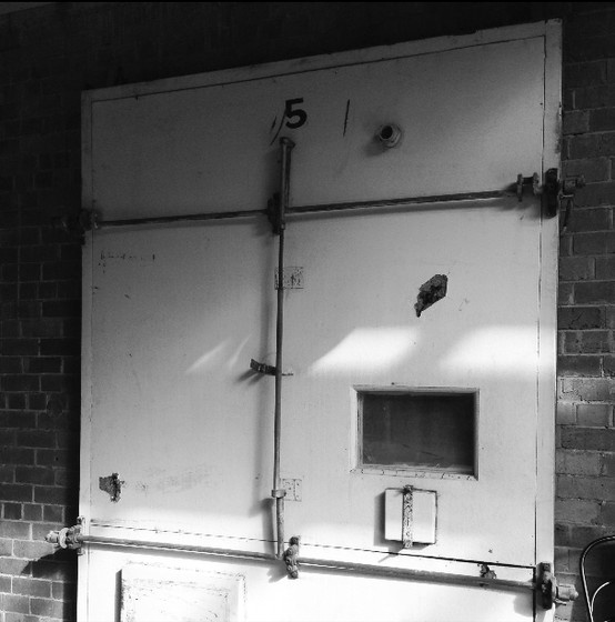 This is one of the original insulated doors used to seal the chambers, which were full of fruit in the Red Hill Cool Stores previous life.