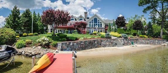 NH Luxury waterfront home with sandy beach Lake Winnipesaukee