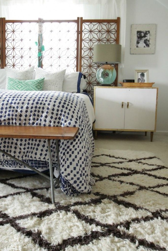 Modern Bohemian Bright White Bedroom- plants, mixed textules, a moroccan rug, asian dresser, and midcentury pieces like a screen headboard bring boho vibes