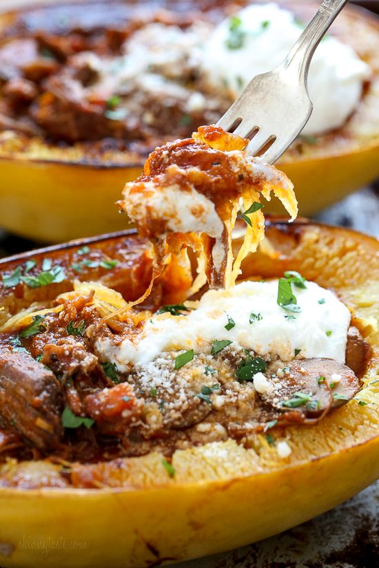 I swapped traditional pasta for roasted spaghetti squash to enjoy this cozy and delicious Beef and Mushroom Ragu served with a dollop of ricotta and grated Pecorino Romano – you won't miss the pasta!