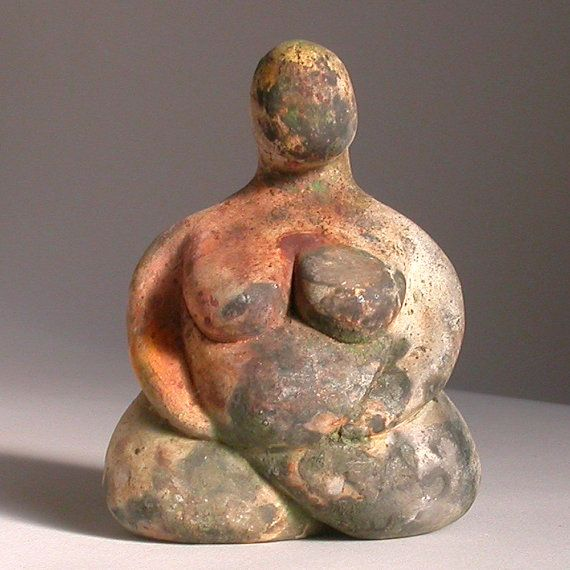 This seated goddess is not based on any specific fertility figurine, but was inspired by plump, seated goddesses found in the neolithic settlement at Catal Huyuk, Anatolia. She is 5 inches high and is 3.8 inches at her widest point. Each figurine is individually hand made, imperfections are to be expected and no two sculptures are alike and can never be reproduced to the exact same effect. They are one of a kind and unique.