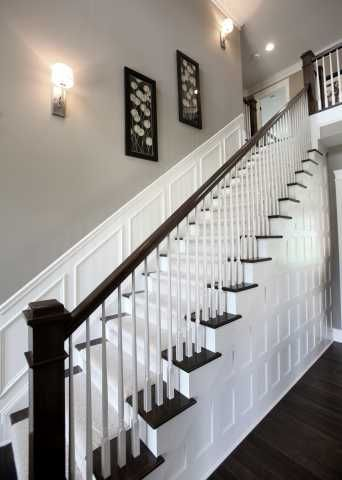 Love the darker wood hand railing and square posts that match the flooring.  The white paneling on the wall under the stairs and the paneling going up the stairs looks gorgeous! http://www.manorhomes.biz/photo-gallery/category/74-2011-parade-of-homes