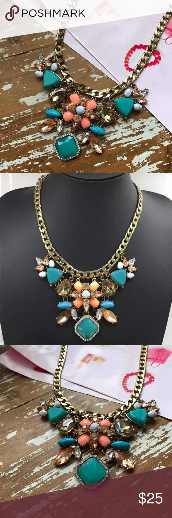 Just In🌷Gold Bold Statement Necklace 🌷 New Boutique Thick gold chain with crew/bib Necklace. Has some Crystal 💎 gems and other resin faux Corals, blue and turquoise stone.📌 Please Note 4/5 picture one small rhinestone got stuck to center stone, it's n
