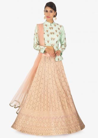 354c85fd745549 Peach lehenga paired with a pistachio blouse with front short back long  along with peach net dupatta