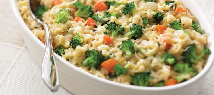 Combine your rice and vegetables in one easy dish. The addition of zesty cheese makes it fit for a special occasion.