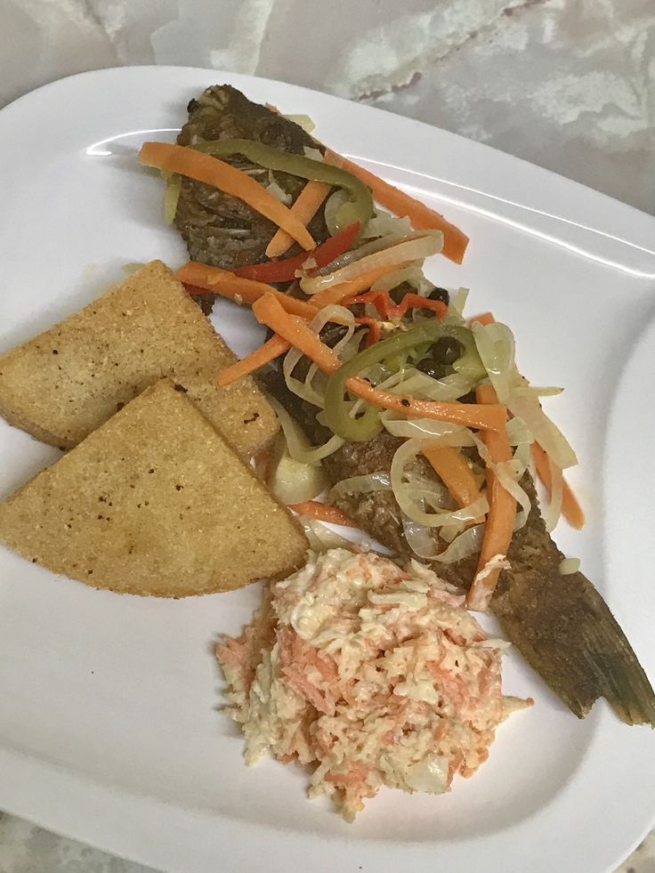 Escovitch fish with bammy and slaw , Jamaican dish