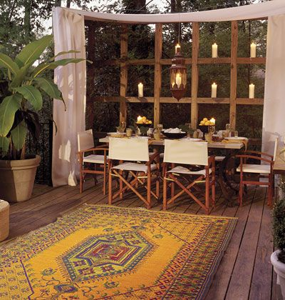 Setting the Mood   To create this look:         Buy a weather-resistant rug for a touch of color in your outdoor room.         Have a buffet or bench custom built to fit your style.         If wiring your patio for more lighting is not in your budget, try hanging glass lanterns from heavy-gauge wire. Fill lanterns with candles, and get your al fresco party glowing.