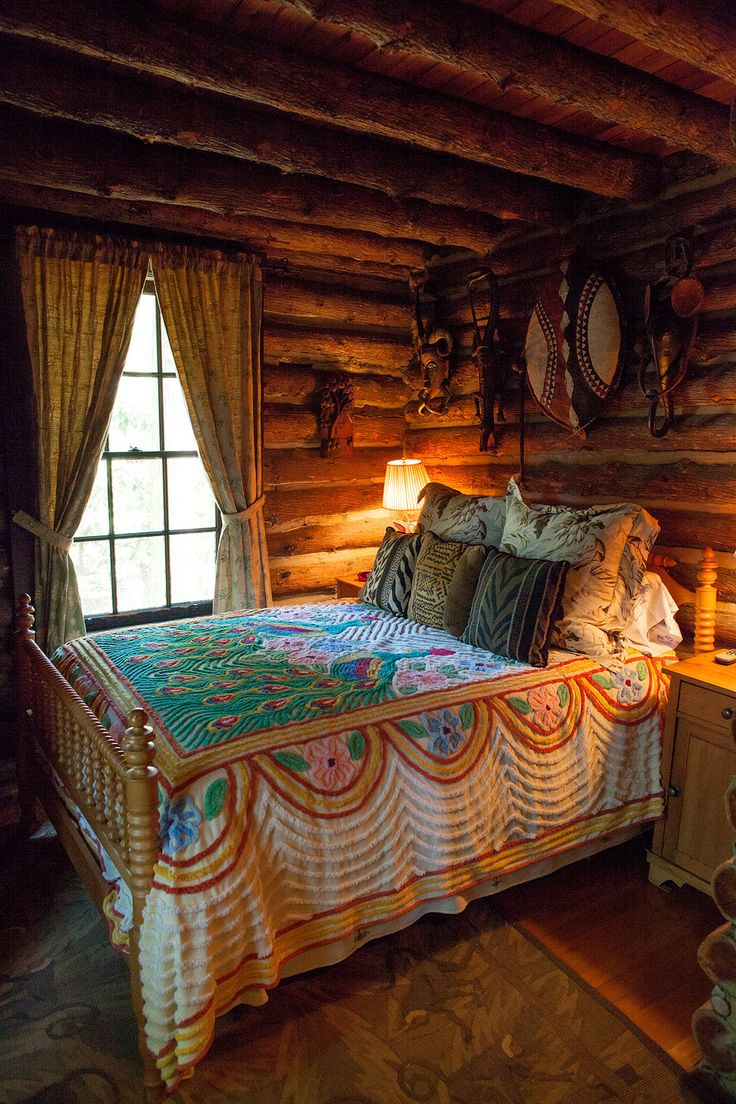 Cabin bedroom fireplace - A Beautiful Vintage Bedspread Brings Extra Cozy To This Room