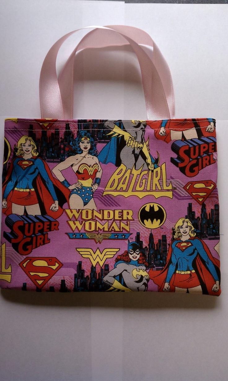 Girl Superhero (BatGirl, Wonder Woman, SuperGirl) Party Favor Bags. $12.95, via Etsy.