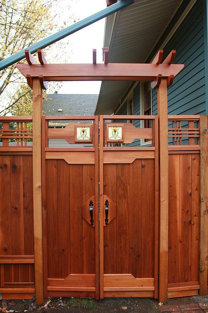 Art deco inspired gate - notice the small dog door on the left hand side.