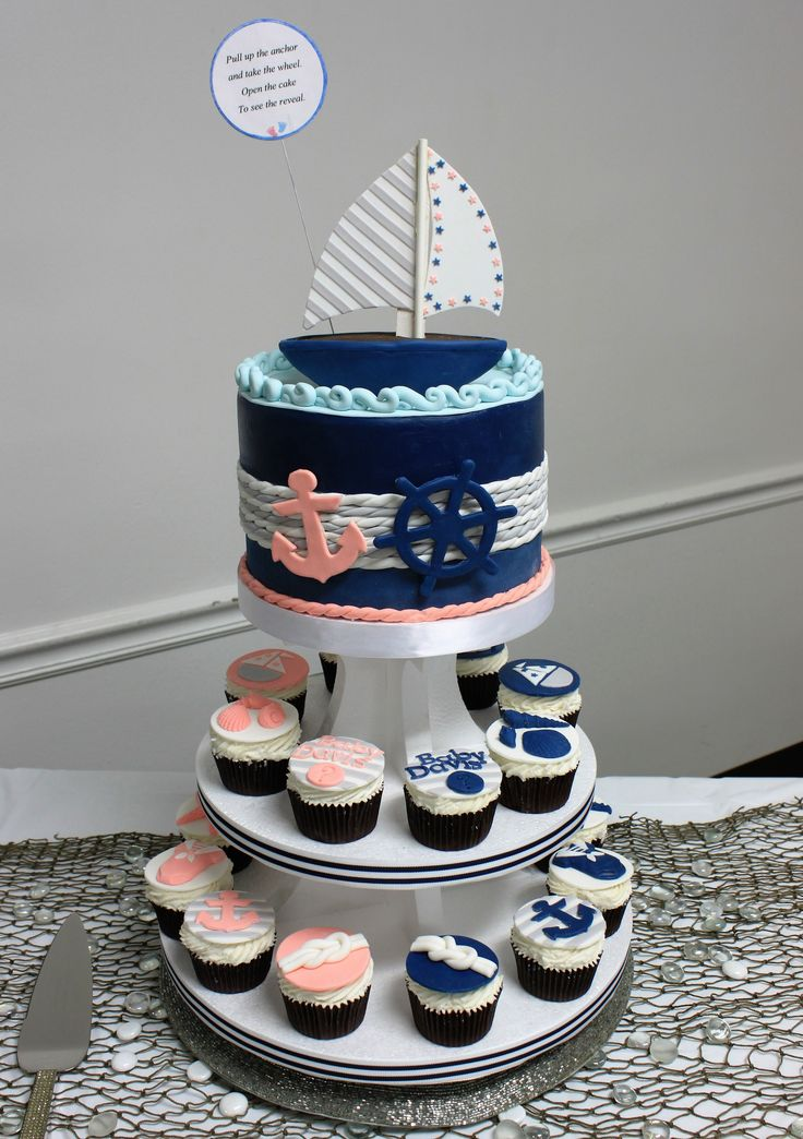 Baby shower cake - nautical theme gender reveal party.  Fondant cake and cupcakes in navy, coral, white and gray.  Click on the picture to see a better view of the cupcakes.  P.S.  It's a girl!