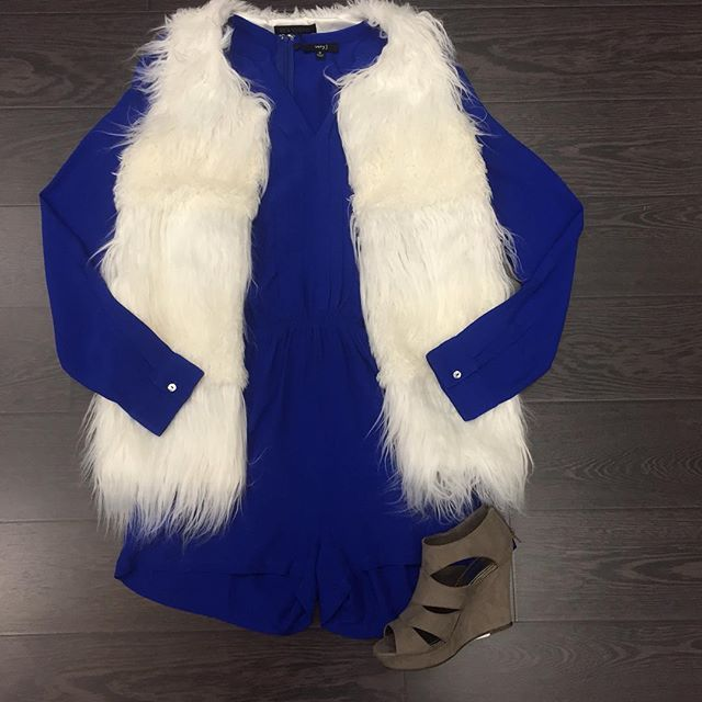 """""""We LOVE vests!!! Blue Romper: $52 White Faux Fur Vest: $60 Wedges: $45"""" Photo taken by @shopflyboutique on Instagram, (09/30/2015) Click this pic to shop purchase right from Fly Boutique Instagram! The perfect outfit for an Ole Miss Rebel or Kentucky Wildcat tailgate or game day!"""