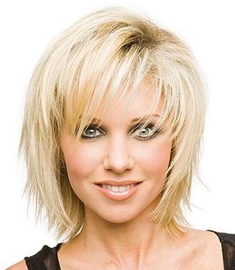 A medium blonde straight coloured choppy platinum volume hairstyle by Steven Carey